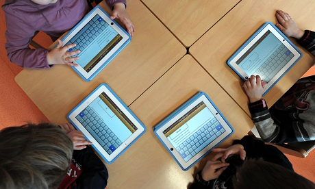 Future education: children use tablets at a nursery.