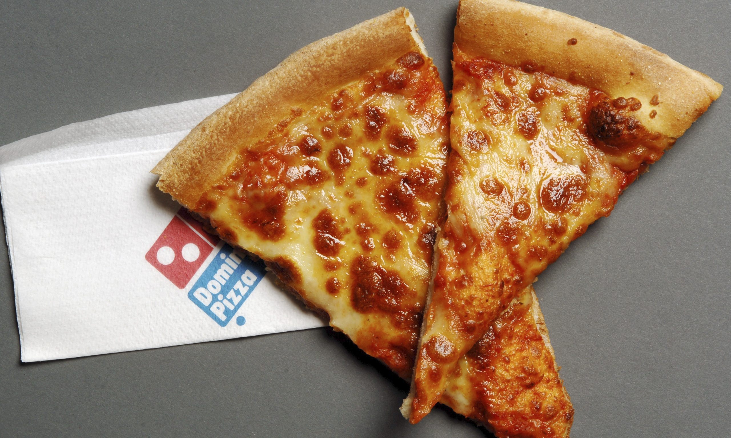The rise and rise of domino 39 s pizza business the guardian for Domino pizza