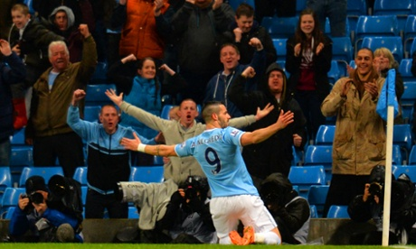 Álvaro Negredo of Manchester City celebrates scoring the opening goal.