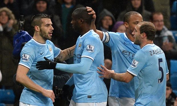 Manchester City's Álvaro Negredo celebrates with his team-mates after scoring in the Capital One Cup match against West Ham.