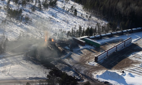 The derailed oil train burning in Plaster Rock, New Brunswick, on Wednesday. Around 150 residents remained evacuated from their homes.