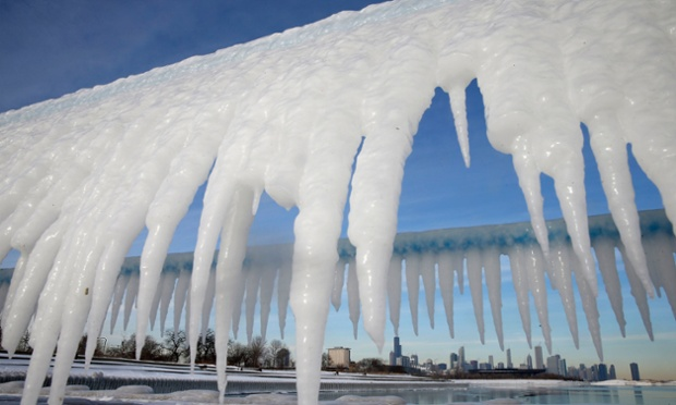 The Chicago skyline framed by icicles in Illinois.