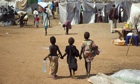Children walk through a camp for refugees at a UN base in Juba
