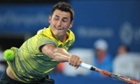 Bernard Tomic returns a shot on his way to victory over Alexandr Dolgopolov.