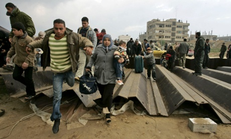Palestinians crossing the border into Egypt