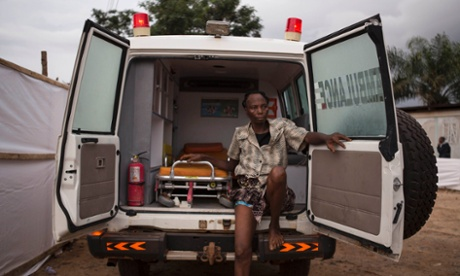 A woman suspected of suffering from the Ebola virus sits in an ambulance in Kenema in Sierra Leone.