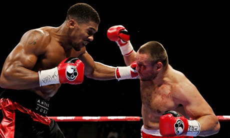 The heavyweight Anthony Joshua, left, made short work of Denis Bakhtov to claim the vacant WBC belt.