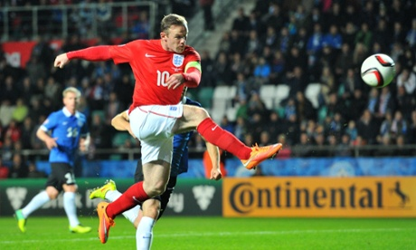 England's forward Wayne Rooney takes a shot at goal during the UEFA 2016 European Championship qualifying group E football match between England and Estonia in Tallinn, Estonia, on October 12, 2014.  AFP PHOTO / GLYN KIRKGLYN KIRK/AFP/Getty Images
