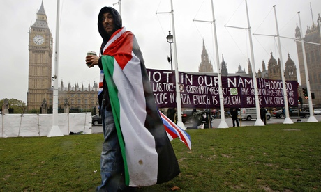 Pro-Palestine supporter outside parliament in London