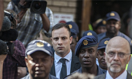 Oscar Pistorius leaves the high court in Pretoria, South Africa. Photograph: Ihsaan Haffejee/EPA