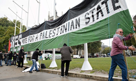 Supporters of British recognition of a Palestinian state with a banner in Parliament Square. Photogr
