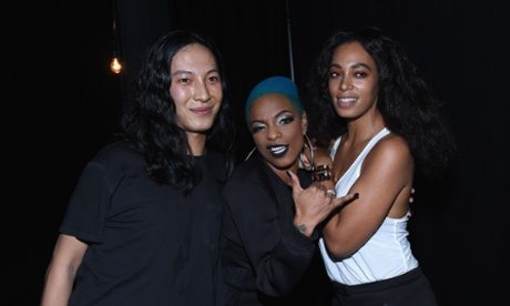 Alexander Wang, Sharaya J, and Solange Knowles pose backstage at the Alexander Wang X H&M Launch on October 16, 2014 in New York City.
