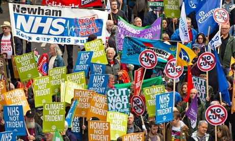 Protesters take part in the 'Britain Needs a Pay Rise' march in London. Photograph: Dominic Lipinski/PA