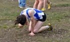 An exhausted cross-country runner in Cofton Park, Birmingham.