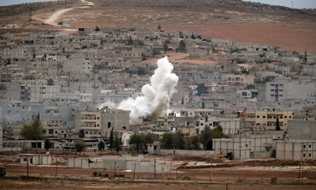Smoke rises following a strike in Kobani, Syria, during fighting between Syrian Kurds and Islamic State militants.