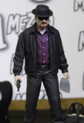 A Walter White Breaking Bad doll, complete with gun and meth.