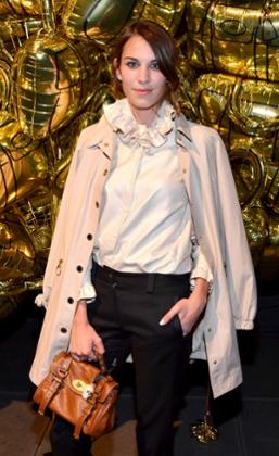 Alexa Chung holding Alexa Mulberry bag