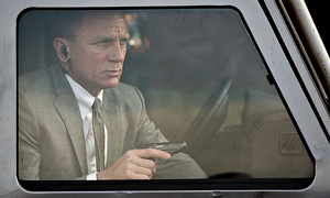James Bond sat with a gun in a car in Skyfall