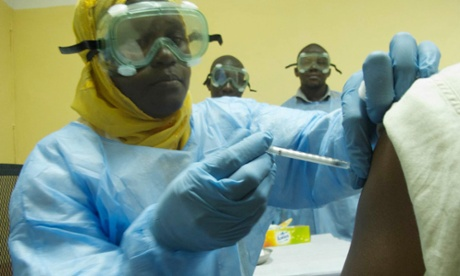 A volunteer recieves the ebola vaccination at the vaccines centre in Bamako, Mali.
