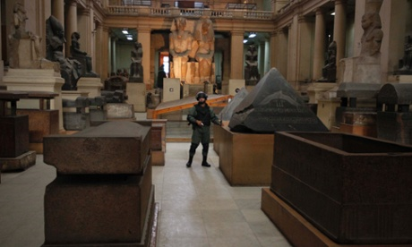 A member of the Egyptian special forces stands guard in the Egyptian Museum in Cairo in January 2011 after would-be looters broke in.