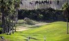 Golfers migrants fence