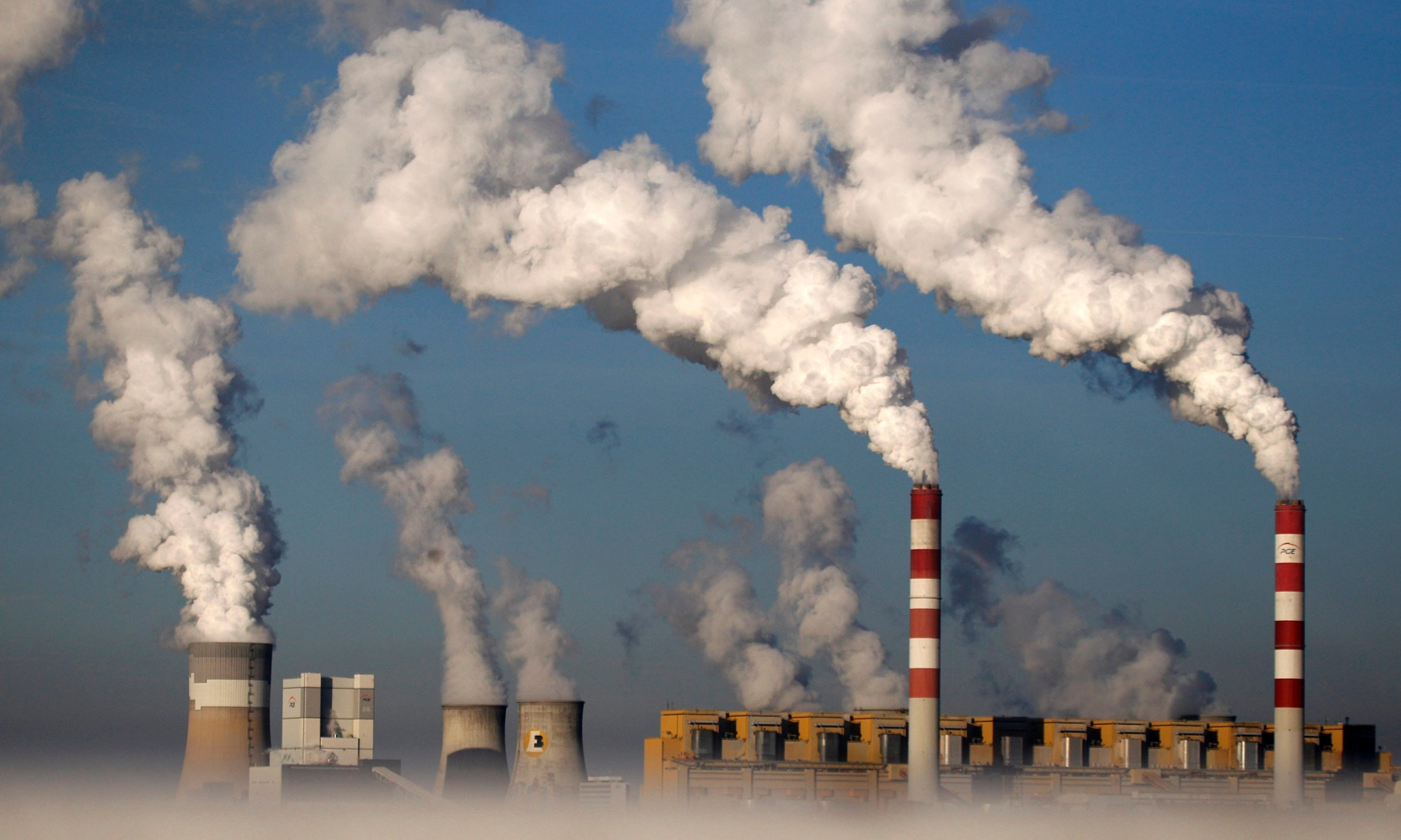 Climate commissioner hails 'strong signal' ahead of global Paris summit but key aspects of deal left vague or voluntary