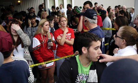 Students wait for family members in a nearby church after the shooting at Marysville-Pilchuck high school.