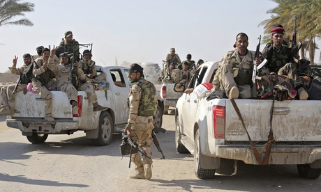 Kurdish and Iraqi government forces make gains against Isis insurgents...