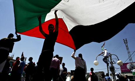 Palestinians with the Palestinian flag in the Gaza Strip