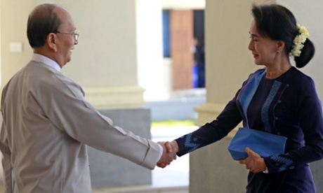 Burma's president, Thein Sein, shakes hands with opposition leader Aung San Suu Kyi before their meeting in the capital, Naypyidaw.