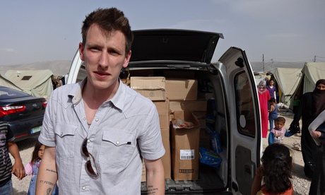 US aid worker Abdul-Rahman (formerly Peter) Kassig delivering aid with the relief organisation he founded, Sera. Photograph: Sera