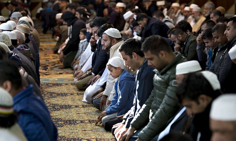 Muslims pray for murdered aid worker Alan Henning in Manchester central mosque. Photograph: Oli Scarff/AFP/Getty Images