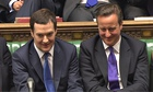Chancellor George Osborne (L) sits next to prime minister David Cameron after presenting the budget