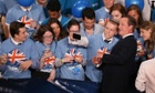 David Cameron poses for photographs with young activists at the Conservative party conference in Birmingham.