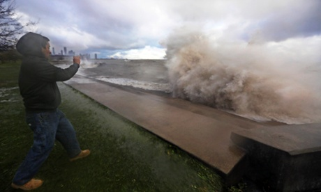 Manuel Hernandez takes video of high waves crashing into a break wall on the south shore of Lake Michigan.