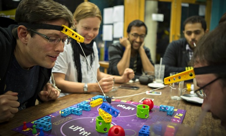 Why play games alone online when you can join in at a board gaming cafe?