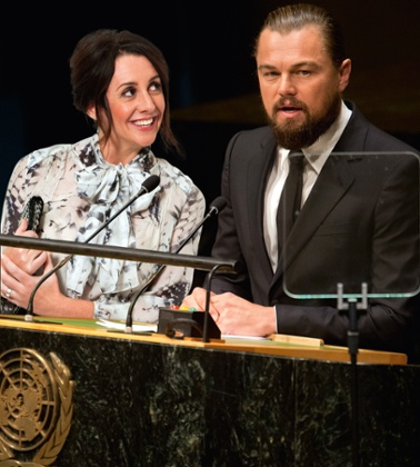 Lucy Siegle joins Leonardo Di Caprio as he delivers a speech during the opening session of the 69th United Nations General Assembly on 23 September 2014, in New York.