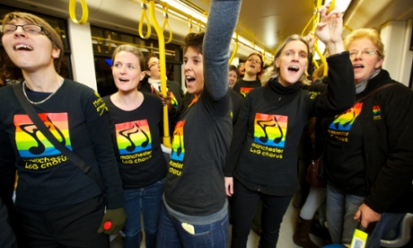 Members of the Manchester Lesbian and Gay Chorus singing on a tram