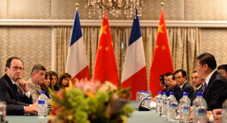 Francois Hollande sits across from China's President Xi Jinping during their bilateral meeting on the sidelines of the G20 summit.
