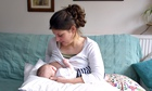 Mother breastfeeding her two-month old baby