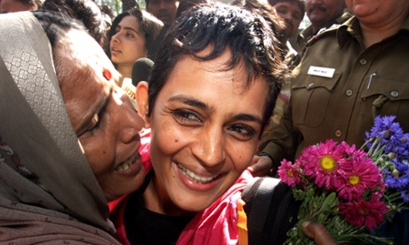 Roy is kissed by supporters in 2002 after being released from Tihar Jail in New Delhi. She had been jailed during a campaign against a new dam.
