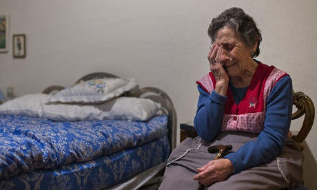 Carmen Martínez Ayudo cries during her eviction in Madrid, Spain. Photograph: Andres Kudacki/AP