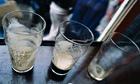Three empty pint glasses