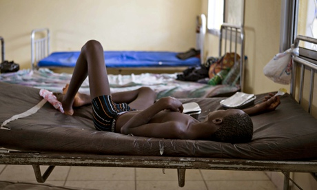 A child suffering from the Ebola virus receives treatment in Makeni, Sierra Leonee