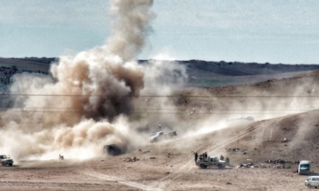 Smokes rises from the Syrian border town of Kobani as Isis militants continue their assault on Kurdish positions.