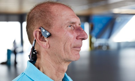 The bone-conducting headset transmits sound through vibration, bypassing the eardrum.