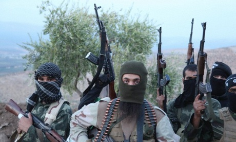 Isis militants in balaclavas with guns in the air