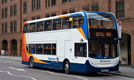 Stagecoach double decker bus by bus stop in Manchester city centre UK