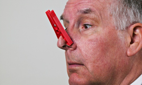 Man with peg on nose