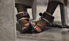 A detainee's feet are shackled in Guantánamo Bay
